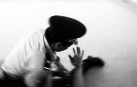 guard beating prisoner
